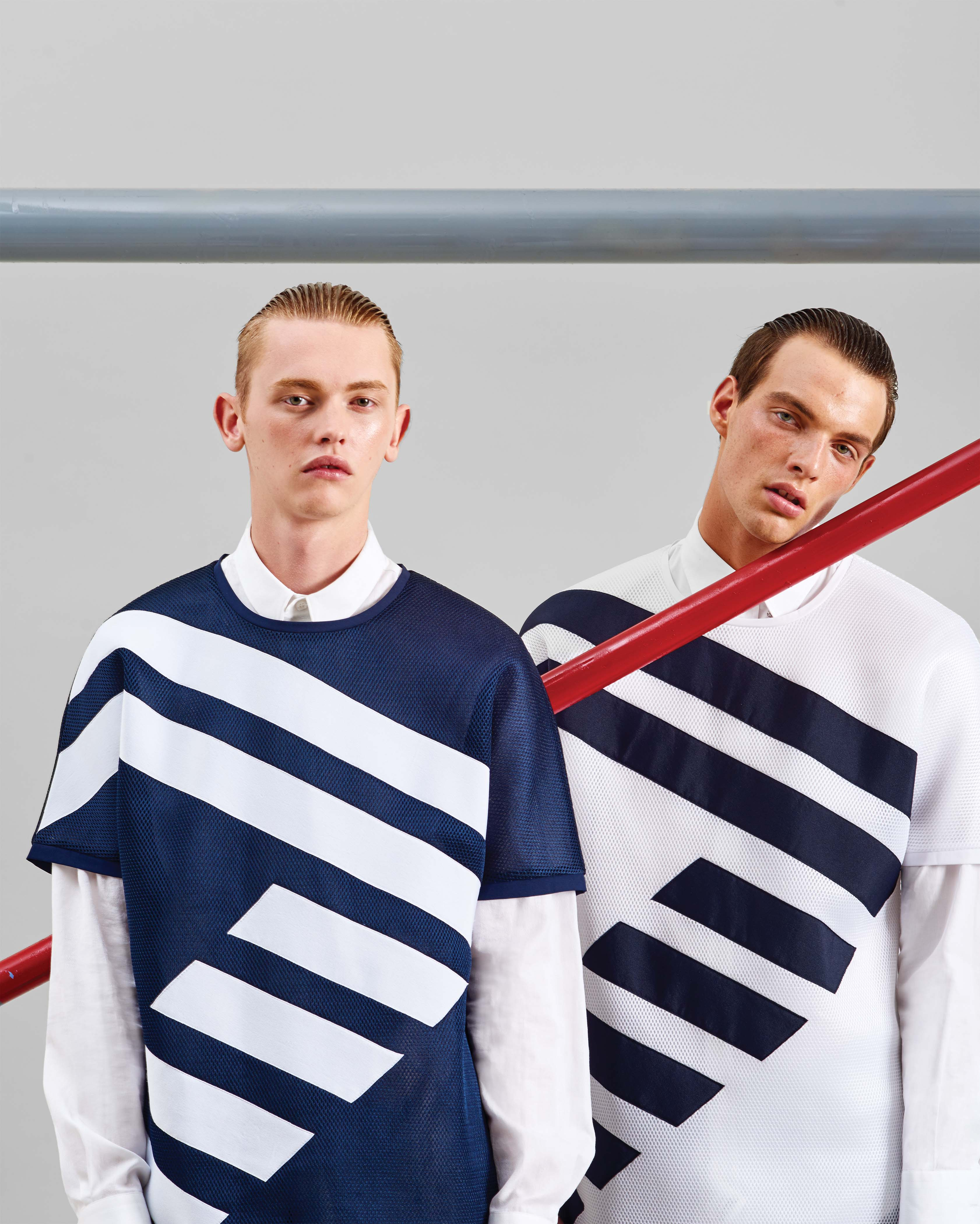 On Both: Emporio Armani's viscose pullover shirt and cotton button-down shirt.