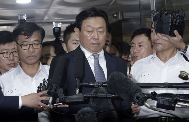Lotte Group's chairman, Shin Dong-bin, center, was indicted on charges of embezzlement and tax evasion.