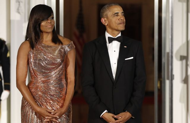 First Lady Michelle Obama in Atelier Versace with President Obama at Tuesday's Italian State Dinner.