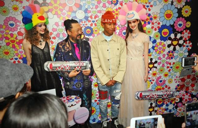 Takashi Murakami and Pharrell Williams with models.