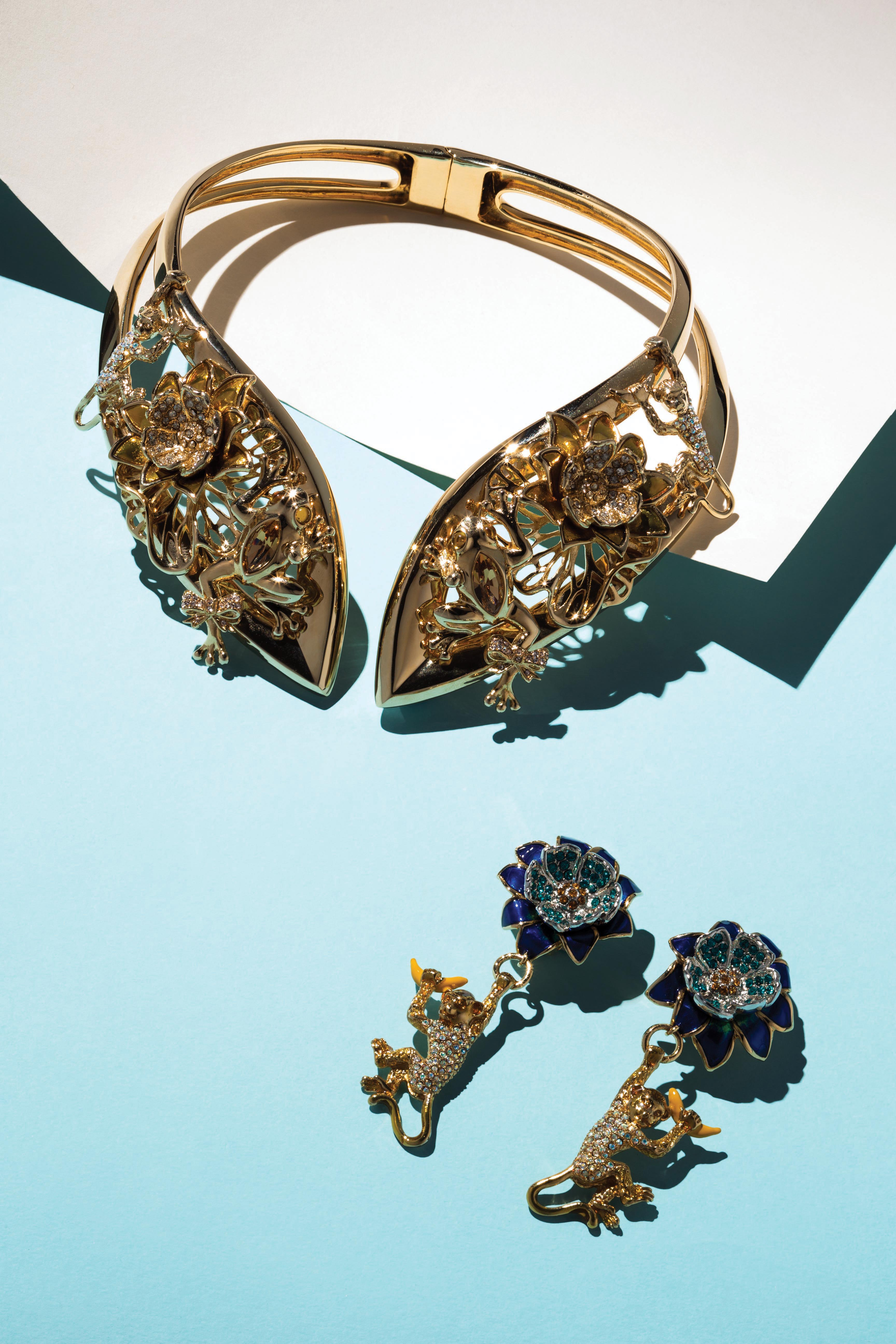 Casadei's gold-plated and crystal pavé torque collar necklace and gold-plated enamel and crystal pavé earrings.