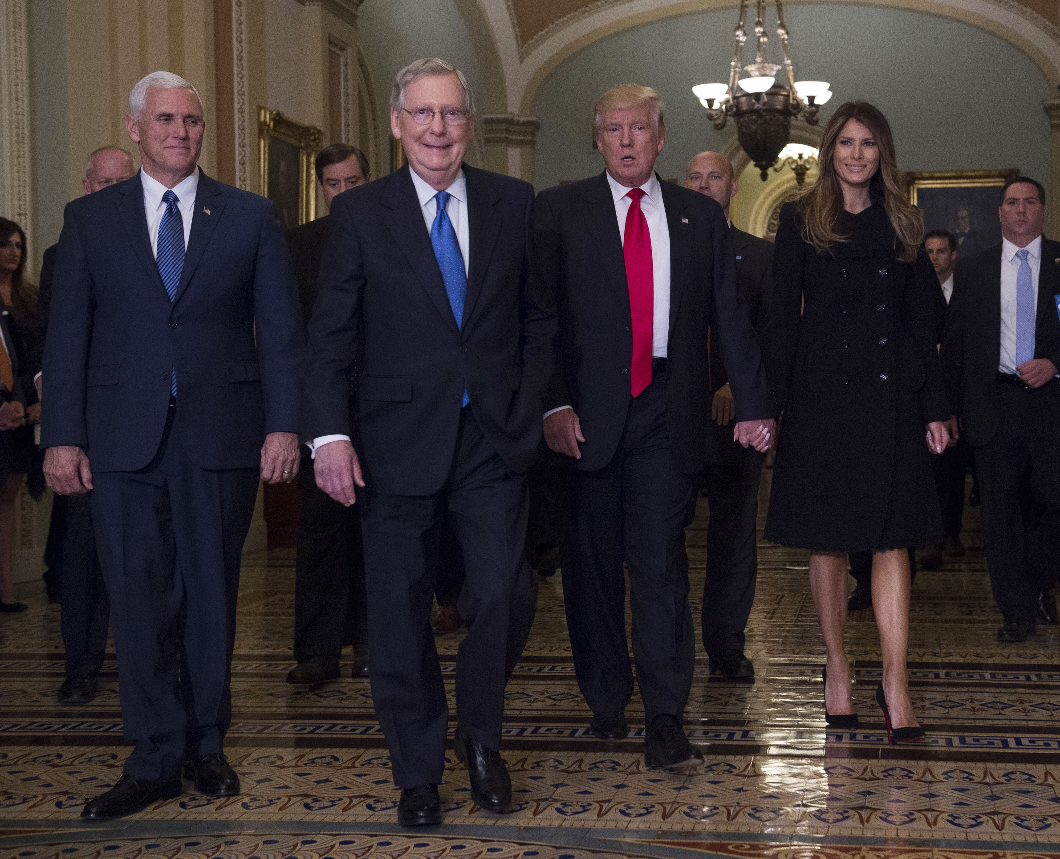 Vice President-elect Mike Pence, Senate Majority Leader Mitch McConnell, President-elect Donald Trump and Melania Trump in the Capitol.