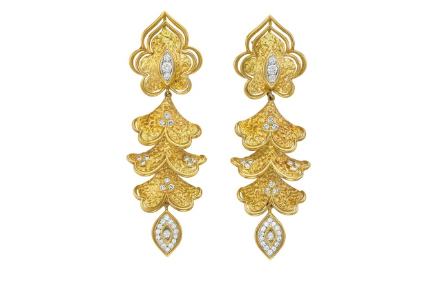 """A pair of gold and diamond ear pendants, by Van Cleef & Arpels, from the private collection, """"Betsy Bloomingdale: A Life in Style."""""""