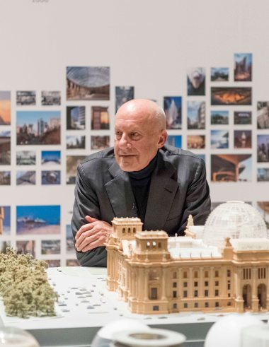 Norman Foster with a model of the Reichstag building.