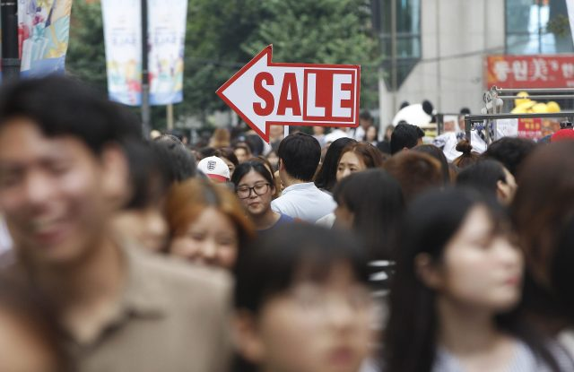 Shoppers fill a street in Seoul, South Korea.