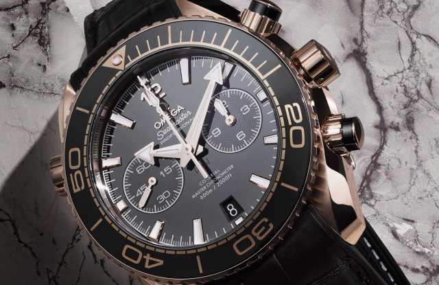 Omega's Seamaster Planet Ocean coaxial master chronometer, 45.5-mm. sedna gold on black leather strap with rubber lining.