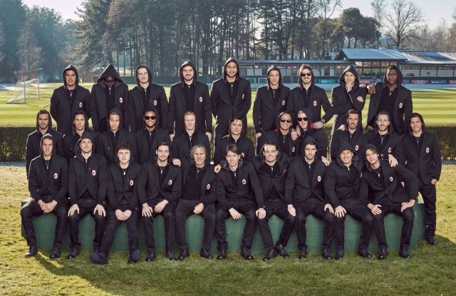 AC Milan players wearing the new uniform designed by Diesel and posing with Renzo Rosso.
