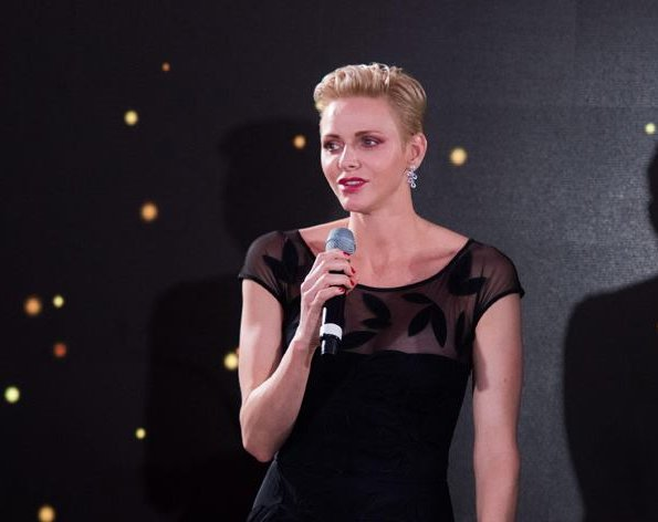 Princess Charlene of Monaco wearing a black gown by designer Chiara Boni.