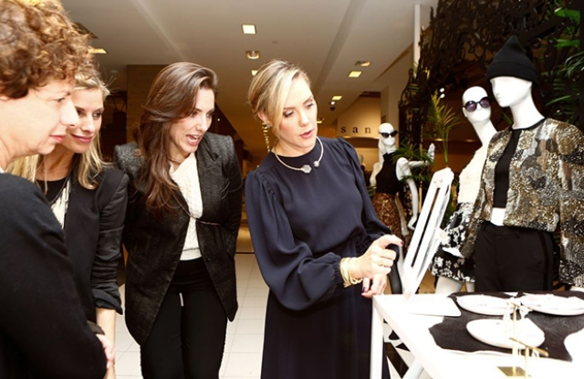 Kendra Scott, right, celebrates the 2015 launch of her brand in Bloomingdale's in New York.