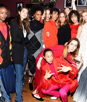 Stella McCartney with models wearing her 2017 pre-fall collection.