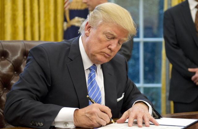 """Donald J. Trump signs three executive orders on """"first day"""" in office, including withdrawing the U.S. from the TPP."""