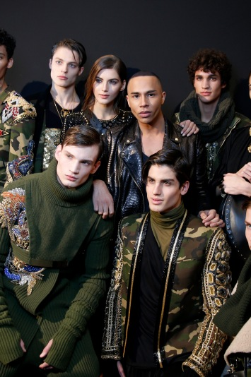 Olivier Rousteing and models backstage at Balmain Men's Fall 2017