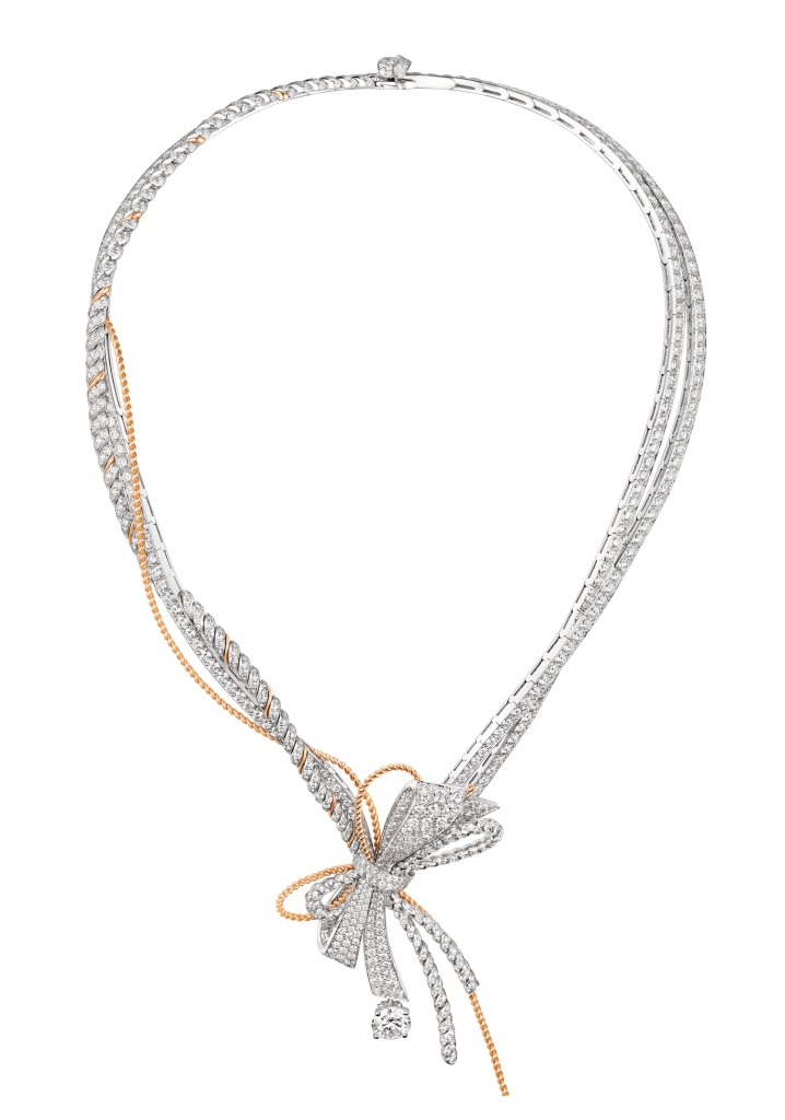 """Chaumet's """"Insolence"""" necklace with an intertwining rose gold chain and white gold ribbon set with round diamonds."""