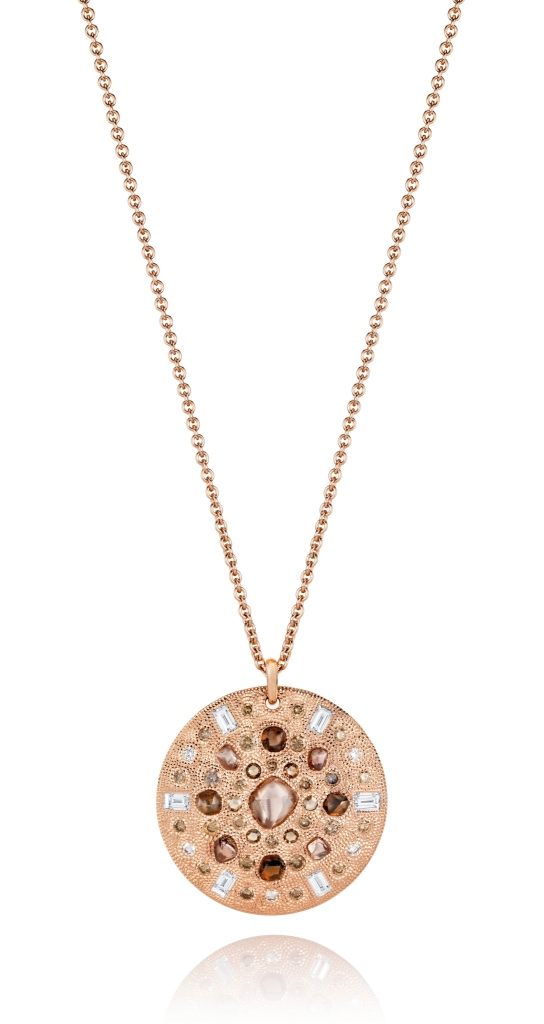 The pink gold Talisman medallion from the De Beers Talisman Collection set with 52 brown rough, rose-cut, baguettes and round brilliant diamonds arranged in circles.