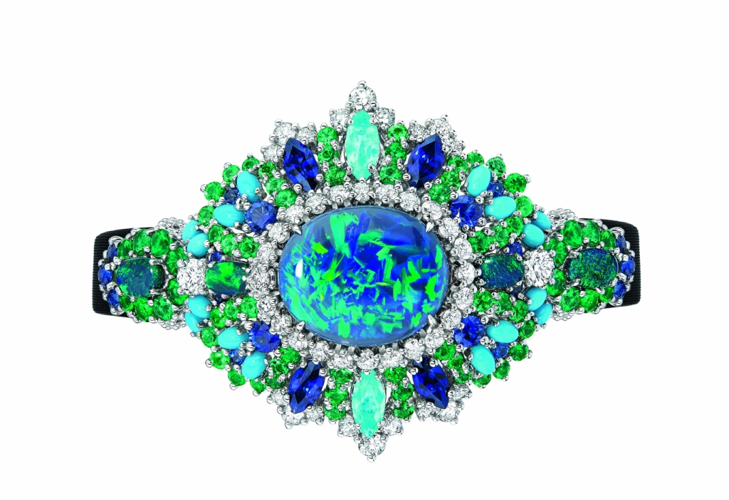 """Dior Joaillerie's """"Exquise"""" high jewelry timepiece in white gold, platinum, diamonds,black opals, emeralds, turquoises, sapphires and Paraiba-type tourmalines. Quartz movement."""