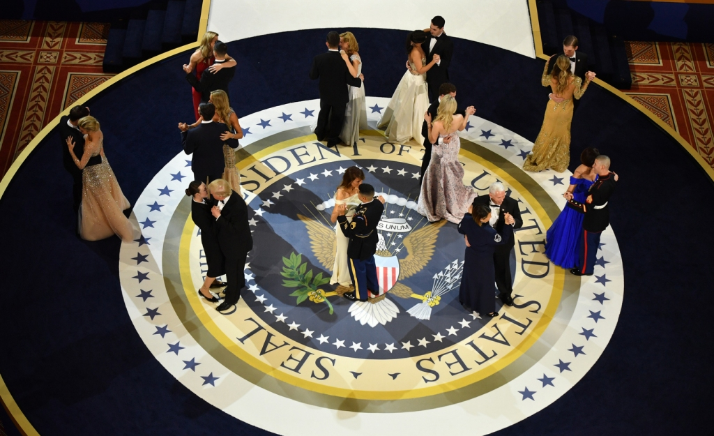 President Donald Trump, First Lady Melania Trump, Vice President Mike Pence and Karen Pence dance with members of the armed services.