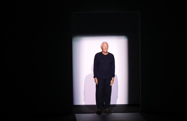 Giorgio Armani takes a bow after his Emporio Armani men's fall 2017 show