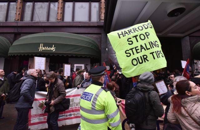Waiter tips demonstration outside Harrods, London.