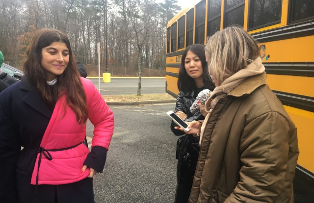 Designer Maryam Nassir Zadeh and two staff members arrive off the school bus in Landover, Maryland