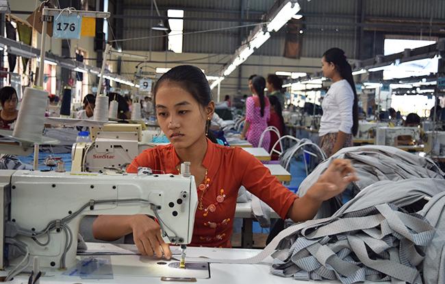 Workers sew garments in Myanmar.