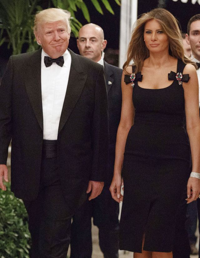 Donald and Melania Trump, wearing Dolce & Gabbana, at their New Year's Eve party.