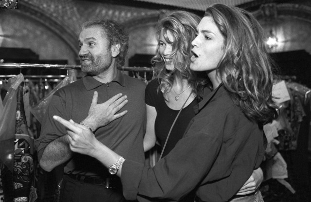 Gianni Versace with supermodels Cindy Crawford and Claudia Schiffer.