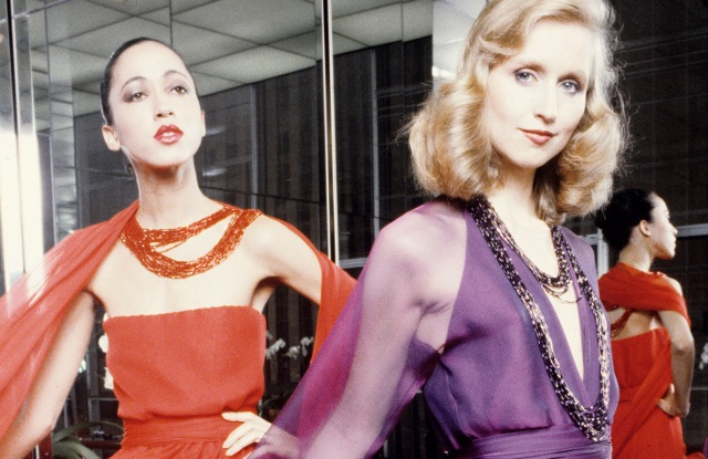 Pat Cleveland and another model wear flowing evening gowns from Halston's Winter Holiday 1979 collection.