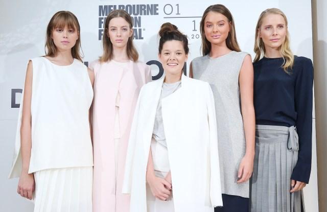 Melbourne Fashion Festival National Designer Award 2017 winner Kacey Devlin (center) flanked by models in her winning collection.