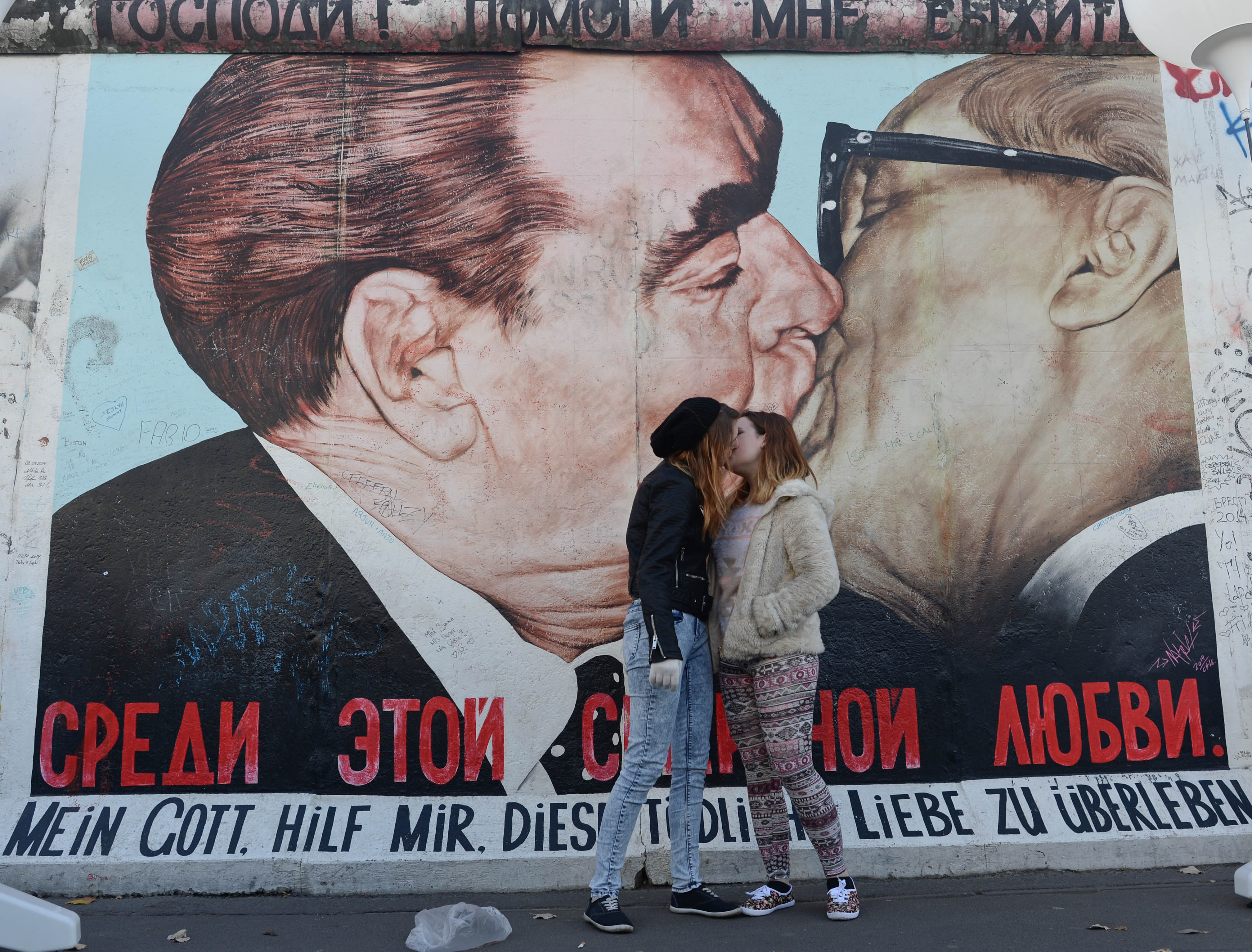 Brezhnev kissing Honecker, painting by Dmitri Vrubel25th Anniversary of the fall of the Berlin Wall commemoration in Berlin, Germany - 08 Nov 2014Thousands of tourists from all around the world arrive for the Celebrations to mark the 25th anniversary of the fall of the Berlin Wall