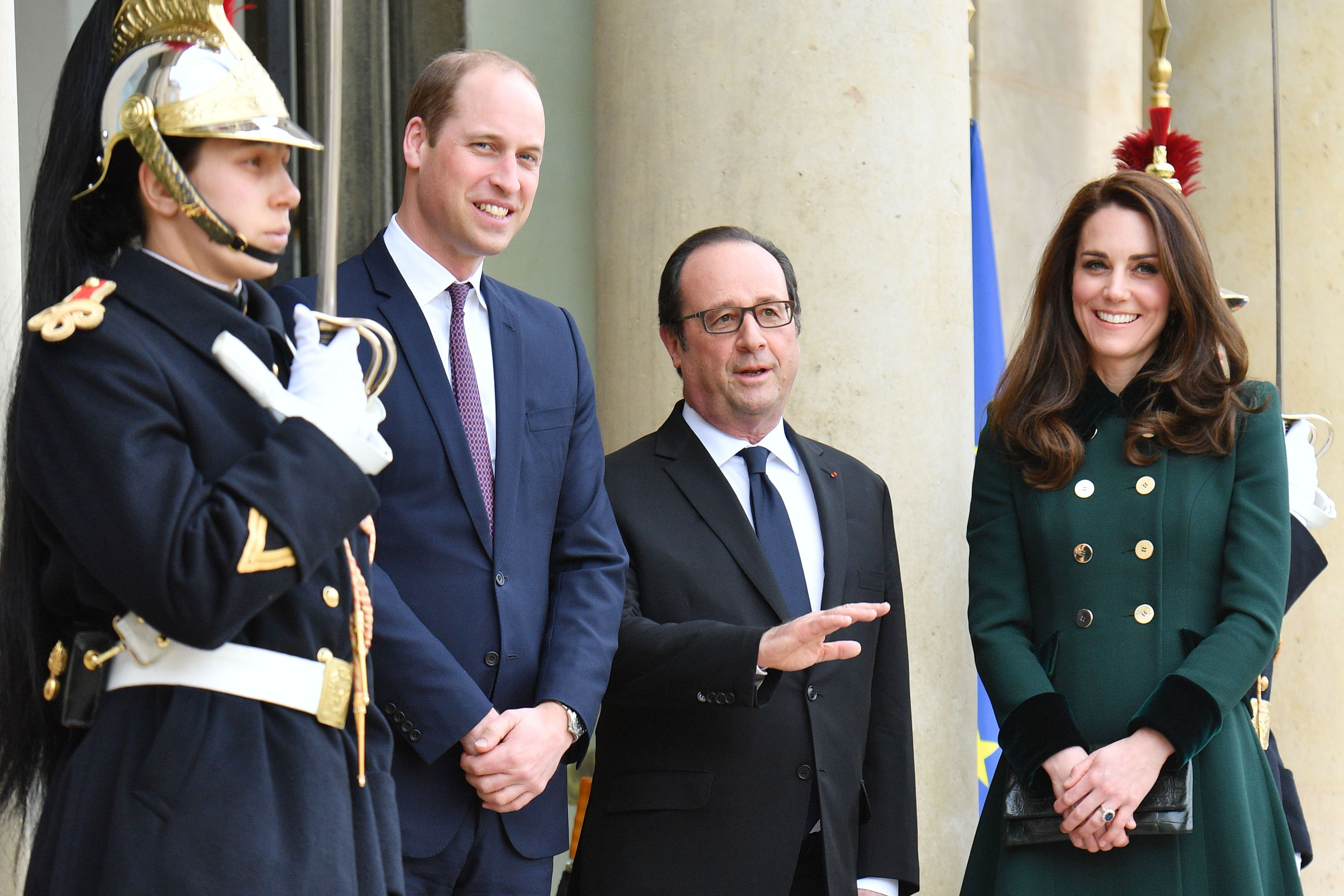 Prince William, Francois Hollande and the Duchess of Cambridge (in Catherine Walker)