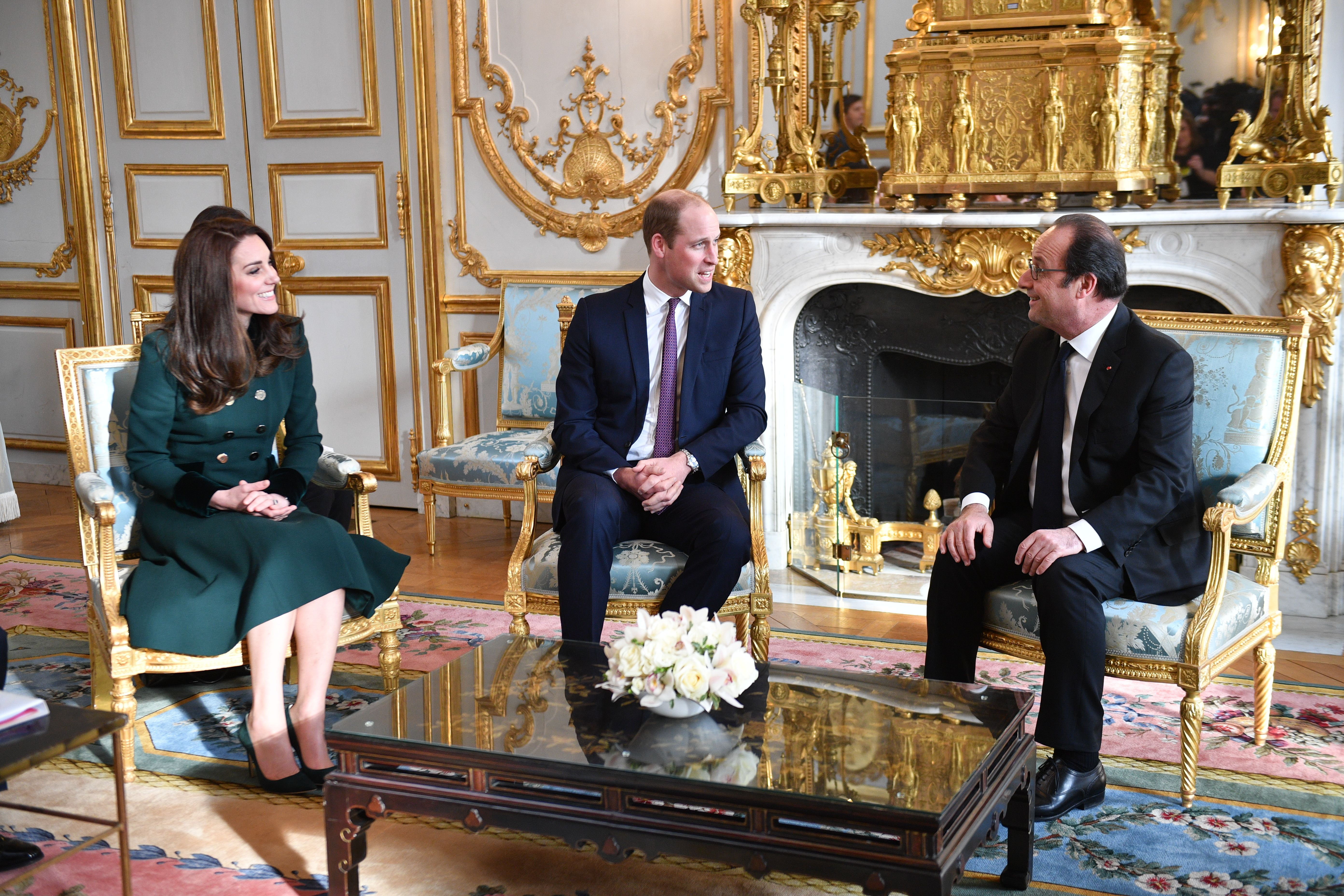 The Duchess of Cambridge (in Catherine Walker), Prince William and Francios Holland