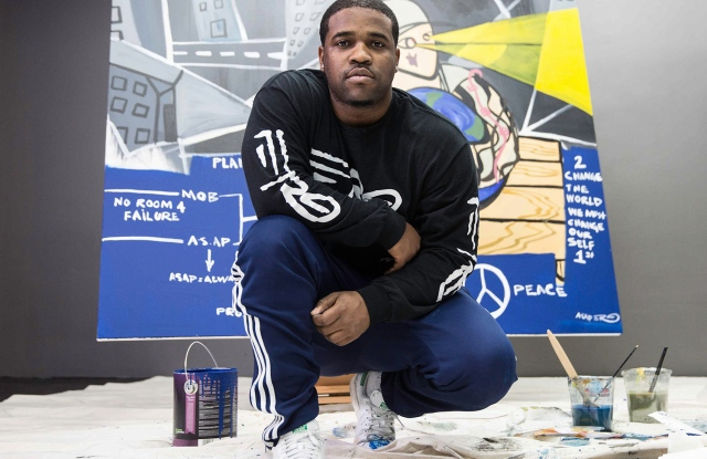 ASAP Ferg with his painting.