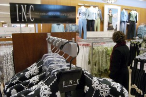 FEDERATED MAY A customer browses through I-N-C clothing, a store-label brand, at a Lazarus-Macy's store, in Cincinnati. Federated Department Stores Inc., which owns Lazarus-Macy's, hopes that its merger with May Department Stores Inc. will boost sales of private-label clothing brandsFEDERATED MAY, CINCINNATI, USA