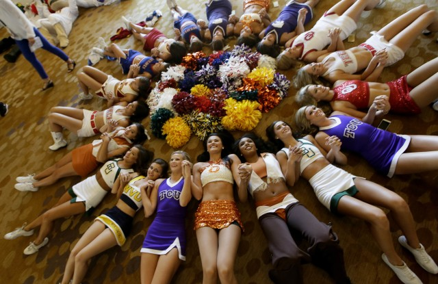 Copyright 2016 The Associated Press. All rights reserved. This material may not be published, broadcast, rewritten or redistributed without permission.Mandatory Credit: Photo by LM Otero/AP/REX/Shutterstock (5775306c)Cheerleaders circle up for a photo during the Big 12 college football media days in Dallas, Tuesday, July 19, 2016.BIG 12 College Football Media Days, Dallas, USA - 19 Jul 2016
