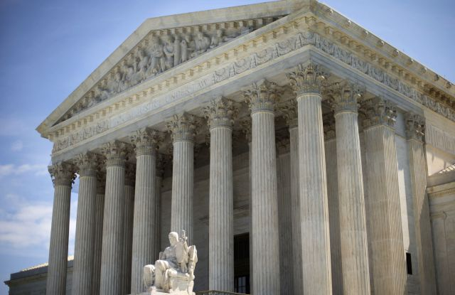 The Supreme Court building is seen in Washington. The Supreme Court, rejected an emergency appeal to stop Texas from enforcing its challenged voter ID law. But the court said it could revisit the issue as the November elections approachSupreme Court Voter ID Texas, Washington, USA