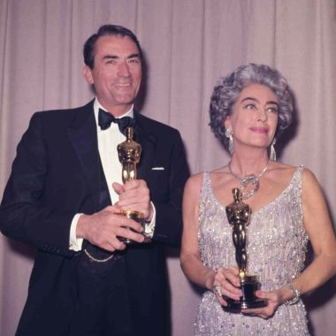 """American actor Gregory Peck with his Oscar after winning his first, after five nominations, as he poses with American actress Joan Crawford, who is holding the Oscar awarded to Anne Bancroft, at the Academy Awards at Santa Monica Civic Auditorium in Los Angeles, Ca., . Peck won best actor for """"To Kill a Mockingbird"""" and Bancroft won for best actress in """"The Miracle WorkerOscars Gregory Peck Joan Crawford, Santa Monica, USA"""