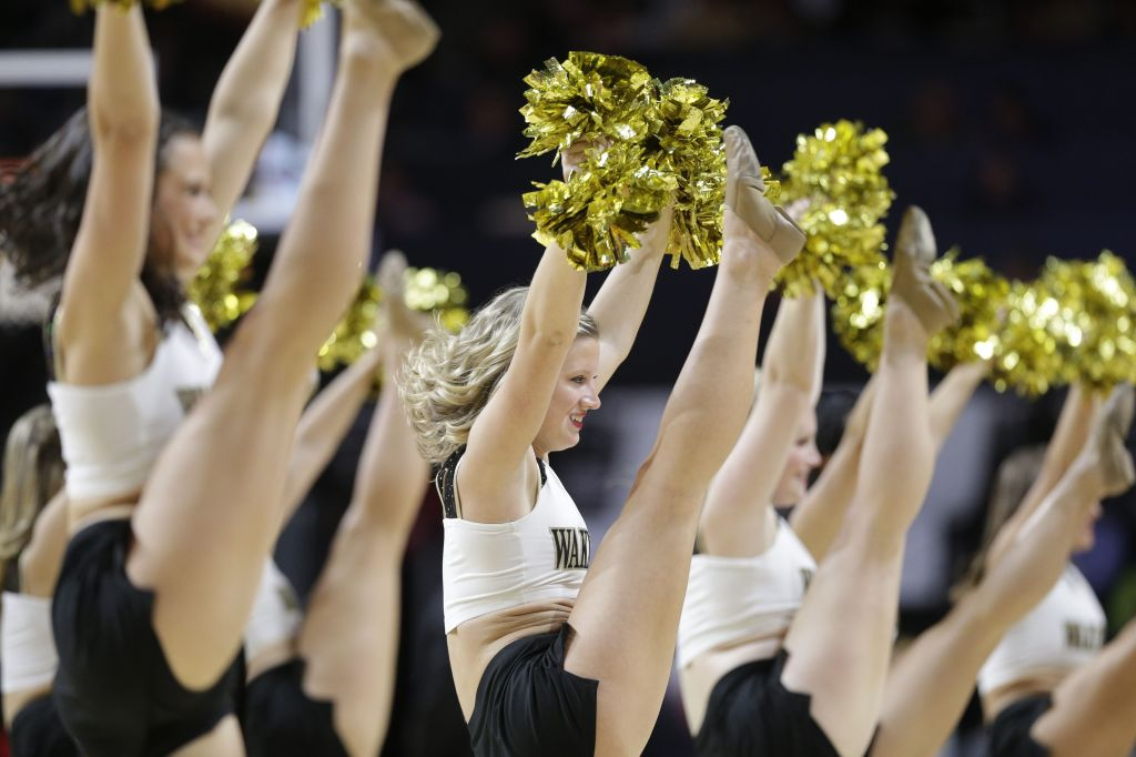 Copyright 2016 The Associated Press. All rights reserved. This material may not be published, broadcast, rewritten or redistributed without permission.Mandatory Credit: Photo by Chuck Burton/AP/REX/Shutterstock (7549282u) Wake Forest cheerleaders perform during the second half of an NCAA college basketball game against Charlotte in Winston-Salem, N.C Charlotte 49ers v Wake Forest Demon Deacons, NCAA basketball game, Winston-Salem, USA - 06 Dec 2016