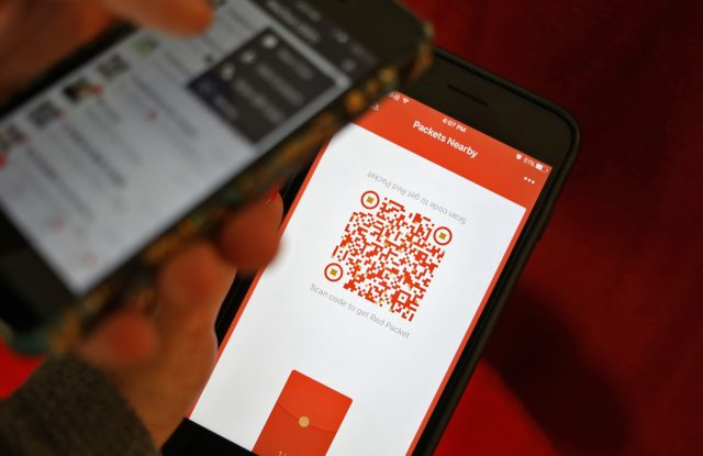 People using WeChat to scan for red packets during Chinese New Year.
