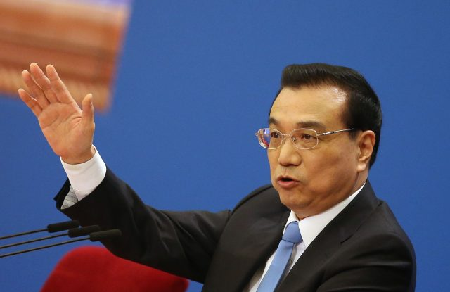 Chinese Premier Li Keqiang gestures during a press conference after the closing of the fifth Session of the 12th National People's Congress.