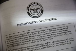 Copyright 2017 The Associated Press. All rights reserved. This material may not be published, broadcast, rewritten or redistributed without permission.Mandatory Credit: Photo by AP/REX/Shutterstock (8521933g) Proposals for the Defense Department in President Donald Trump's first budget are displayed at the Government Printing Office in Washington, Thursday, March, 16, 2017. The $1.15 trillion presentation proposes a reordering of national spending priorities, pumping significantly more money into the military and homeland security while sharply cutting foreign aid, medical research and the arts. The document also proposes money for the U.S.-Mexico border wall Trump vowed in his campaign to have Mexico finance. The EPA also takes a big hit in the budget proposal Trump Budget, Washington, USA - 16 Mar 2017