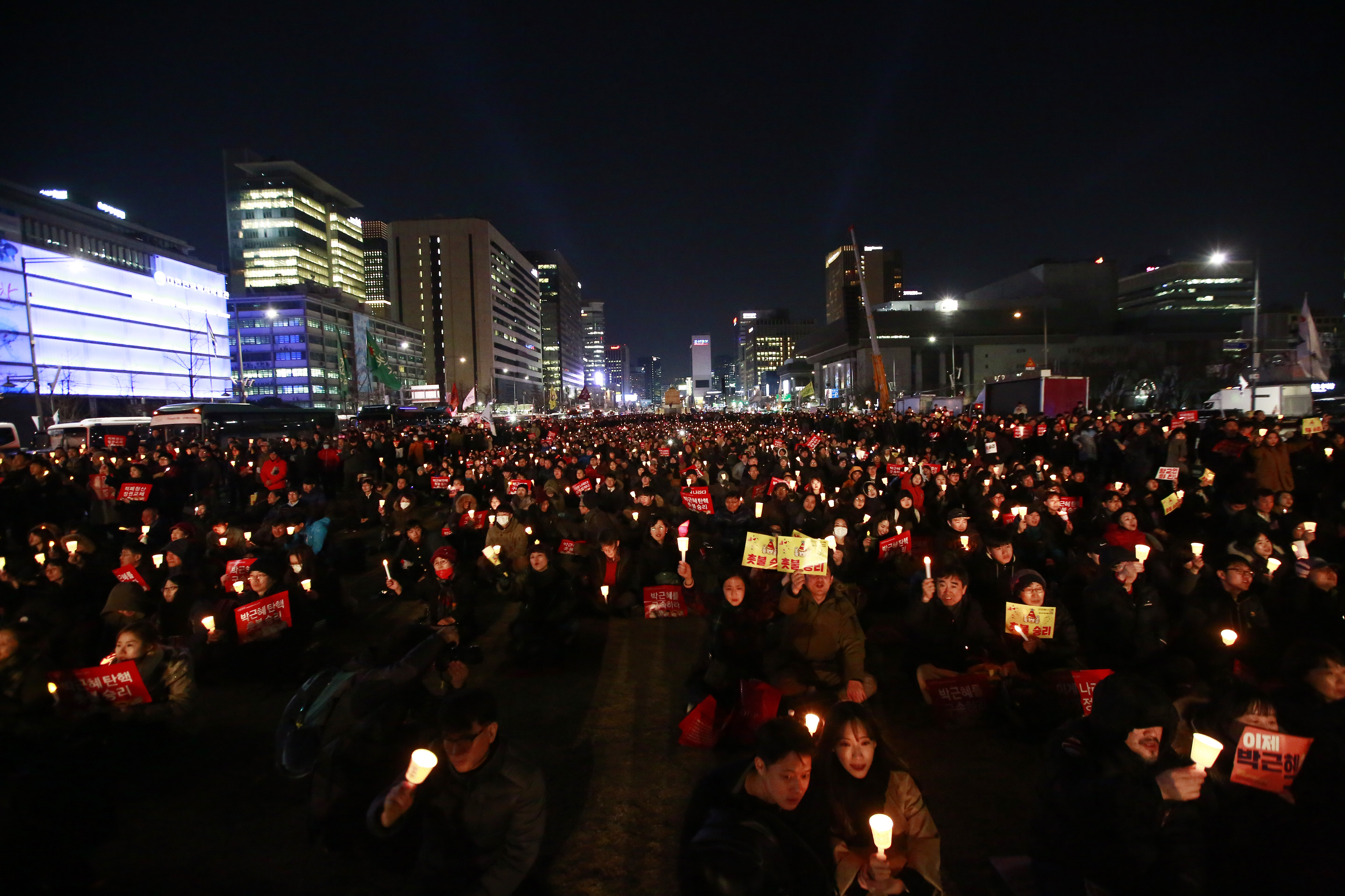 South Koreans gather while holding candles to celebrate after the court's ruling on the impeachment of South Korean President Park Geun-hye in downtown Gwanghwamun in Seoul, South Korea, 10 March 2017. Impeached South Korean President Park Geun-hye is to be permanently removed from office after the Constitutional Court announced its ruling on 10 March. A snap election is expected to take place in early May 2017.Court announces ruling on South Korean President Park impeachment, Seoul, Korea - 10 Mar 2017