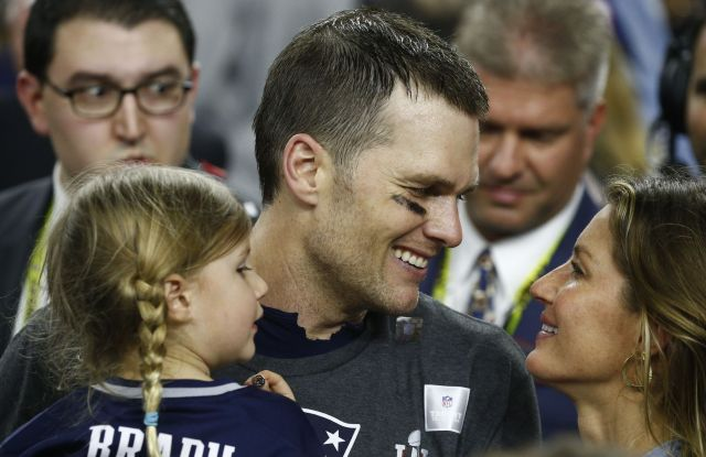 New England Patriots quarterback Tom Brady (C) talks with his wife, Gisele Bundchen (R), as his daughter, Vivian Lake Brady (L) looks on after winning the first overtime Super Bowl against the Atlanta Falcons in Super Bowl LI at NRG Stadium in Houston, Texas, USA, 05 February 2017.Super Bowl LI, Houston, USA - 05 Feb 2017