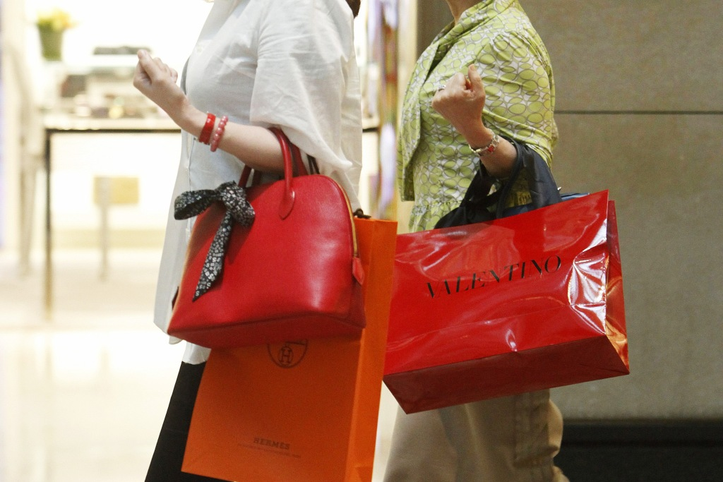 Mainland Chinese Tourists Are Seen with Luxury Brand Shopping Bags in Hong Kong China 17 May 2011 the Strength of the Chinese Yuan Against the Hong Kong Dollar Makes Shopping in Hong Kong Inexpensive For the Emerging Middle Classes of China who Often Travel to Hong Kong to Buy Luxury Goods and Even Apartments in the City China Hong KongChina Hong Kong Luxury Shopping - May 2011