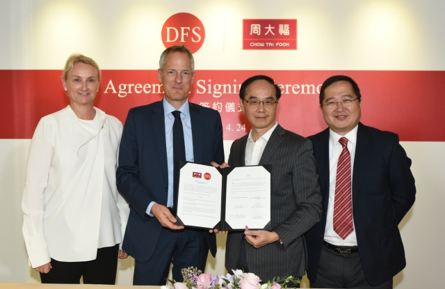 DFS chief executive officer Philippe Schaus (center left) at the signing ceremony with Chow Tai Fook managing director Kent Wong (center right).