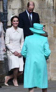 The Duchess of Cambridge (in Catherine Walker) bows as The Queen Elizabeth II arrives .