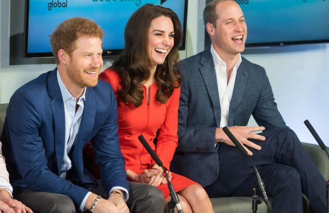Prince Harry, the Duchess of Cambridge (in Armani Collezioni) and Prince William