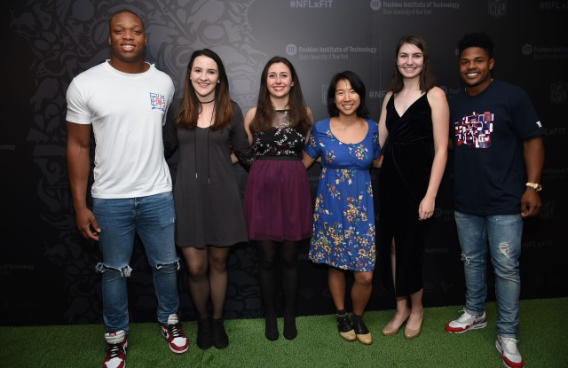 NFL players Romeo Okwara, left, Sterling Shepard, far right, pose with FIT students at the NFLxFIT Visual System Design Contest and Exhibition at The Museum at FIT on Tuesday, April 18, 2017, in New York. (Photo by Evan Agostini/Invision for The Fashion Institute of Technology/AP Images)