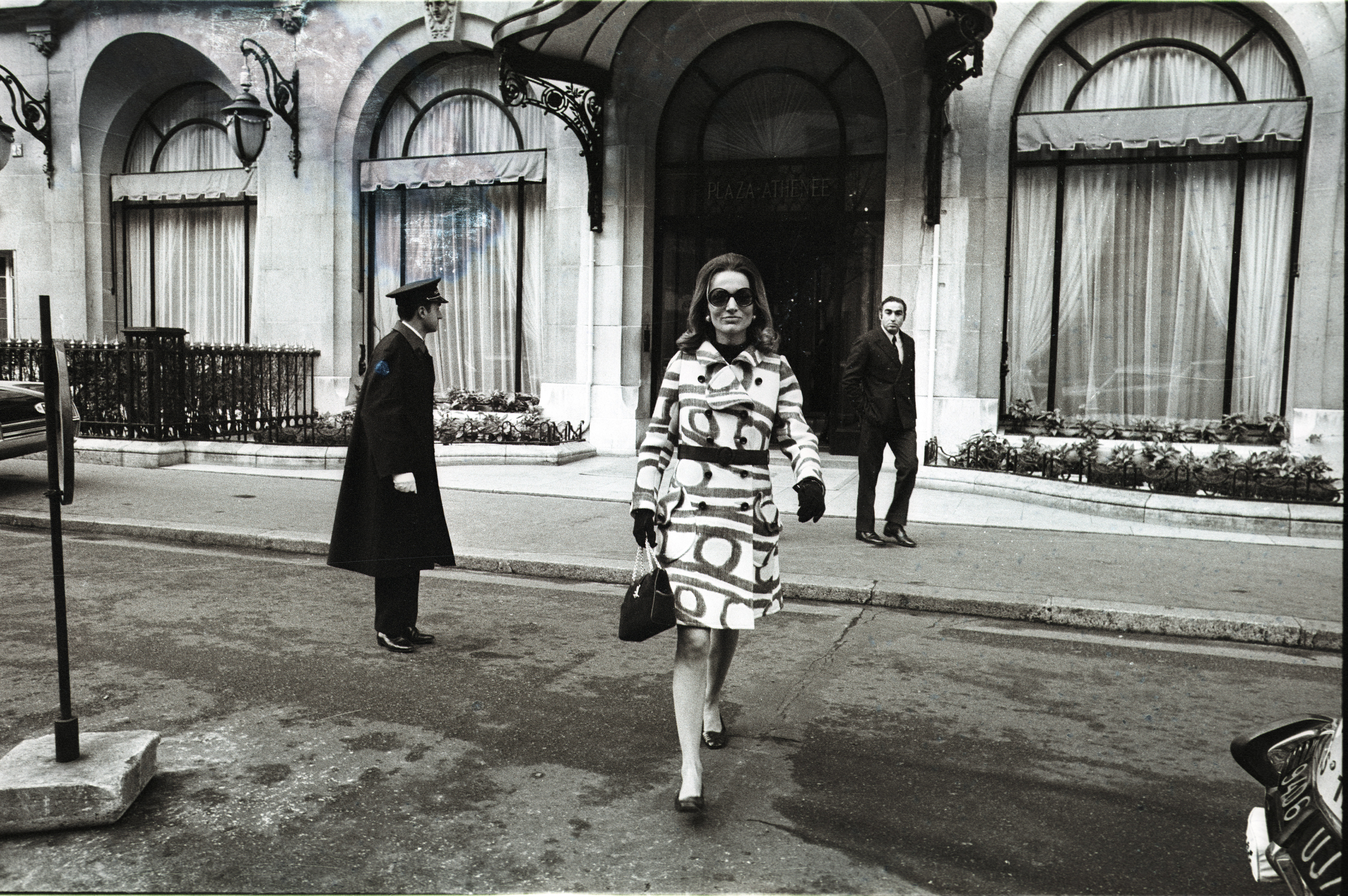 """Lee Radziwill in Paris leaves her hotel, """"The Plaza Athenee"""" and walks past Christian Dior boutique."""