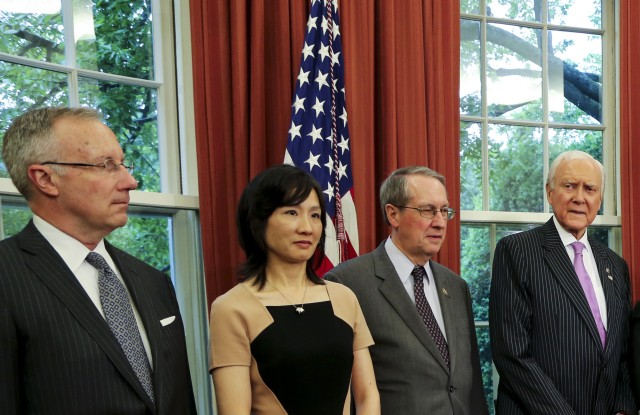 Michelle Lee (center left) during President Obama's 2016 signing of the Defend Trade Secrets Act.