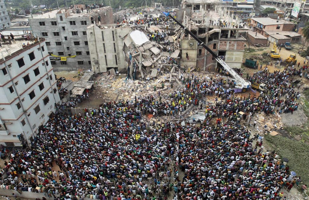 A crowd gathered where Rana Plaza used to stand. The building collapsed on April 24, 2013.